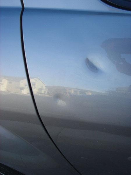dented car before Carrollton Texas Dent Repair